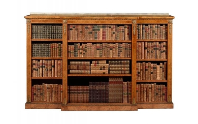 A Victorian walnut, figured burr walnut and gilt metal mounted breakfront bookcase, circa 1860