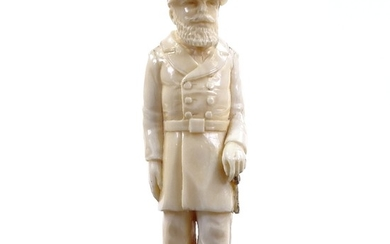 A carved ivory figure of a man in military uniform, unsigned...
