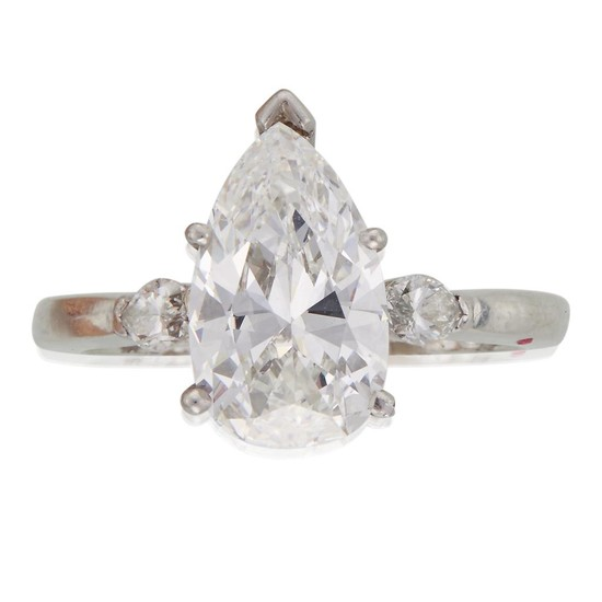 A diamond solitaire centering a pear-shaped diamond weighing 3.06...