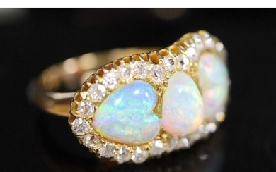 A gold, three stone white opal and diamond set cluster ring,...