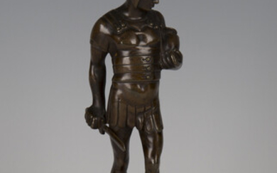 A late 19th century Continental brown patinated cast bronze figure of a Roman soldier holding a shor