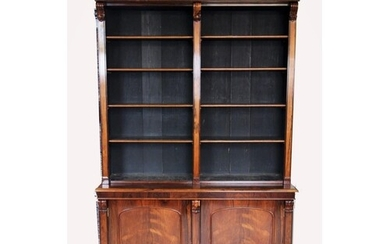 A mid 19th century rosewood library open bookcase, with a ca...