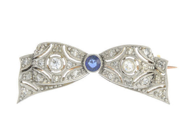 A mid 20th century platinum and gold sapphire and vari-cut diamond bow brooch.