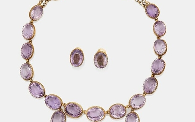 A necklace and a pair of earrings in silver set with amethysts