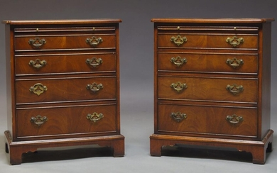 A pair of George III style mahogany bachelor's chests, late...