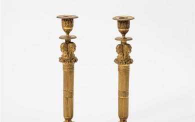 A pair of gilt-bronze Empire-style candlesticks France, 19th/20th...