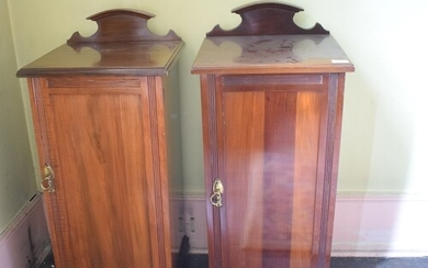 A pair of late Victorian walnut bedside cupboards, 38 cm wid...