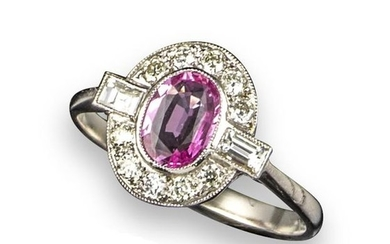 A pink sapphire and diamond cluster ring, the...
