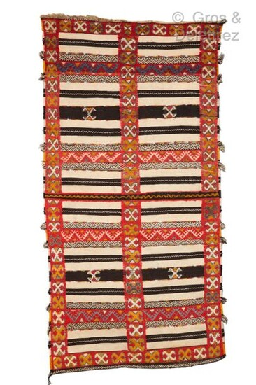 A rug in mixed technique knotted and woven from Ait...