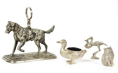 A silver plated model of a dog