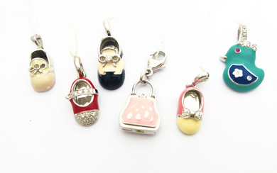 A special lot of charm pendants, 18K gold with...