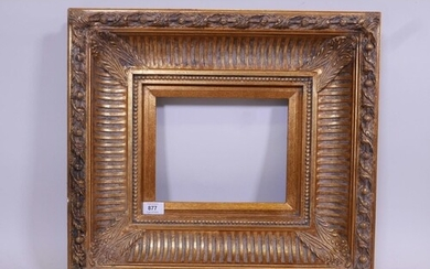 A 'Carvers & Gilders' heavy gilt frame with composition mou...