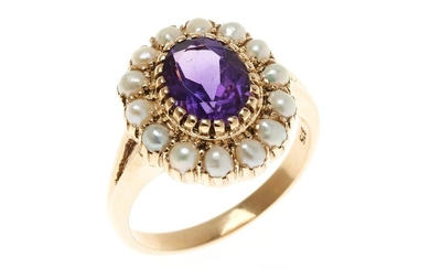 AN AMETHYST AND PEARL CLUSTER RING; centring an oval cut fine deep purple amethyst to surround of seed pearls, in 9ct gold, size N1/2.
