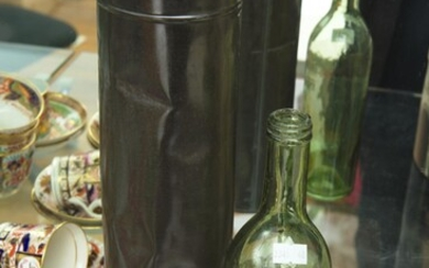 AN ANTIQUE FRENCH WINE EXCISE BOTTLE IN ORIGINAL METAL CYLINDER WITH LID