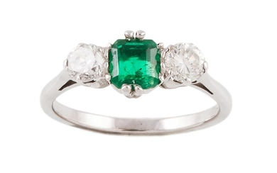 AN EMERALD AND DIAMOND THREE STONE RING, one rectangular ste...