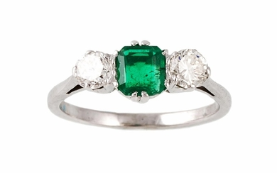 AN EMERALD AND DIAMOND THREE STONE RING, with one emerald of...
