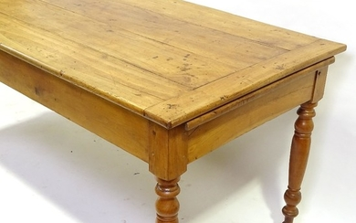 An 18th century French chestnut kitchen table with plank top...