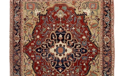 An antique Heriz rug, North West Persia. Executed with the finest sense of natural colour combination. C. 1900. 195×165 cm.