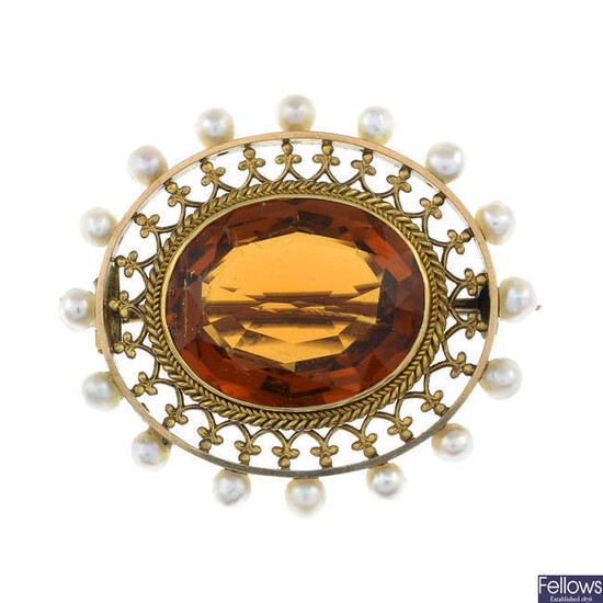 An early 20th century citrine and split pearl brooch.