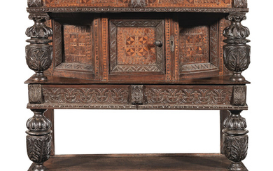 An impressive Elizabeth I joined walnut, oak and parquetry-inlaid canted court cupboard, Dorset, circa 1590