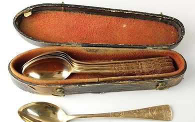 Baroque case with later gilded silver coffee spoons, elongated wooden case, around 1800, the inside lined with red velvet, the outside with black embossed paper, l 16.5 cm, w 4 cm, h 4.5 cm, six gilded silver spoons, Germany, around 1900, with floral...