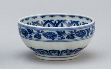 CHINESE BLUE AND WHITE PORCELAIN BOWL Bands of lotus flowers and vines about the interior and exterior. Four-character Kangxi mark o...