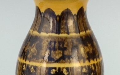 CHINESE BROWN AND YELLOW GLAZE PORCELAIN VASE In pear shape, with trumpet mouth and a fret and lappet design on body. Impressed six-...