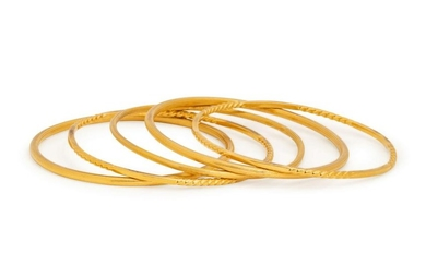 COLLECTION OF YELLOW GOLD BANGLE BRACELETS