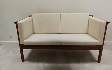 NOT SOLD. Christian Hvidt: Two-seater sofa with mahogany frame. Manufactured by Søborg Møbler. H. 76....