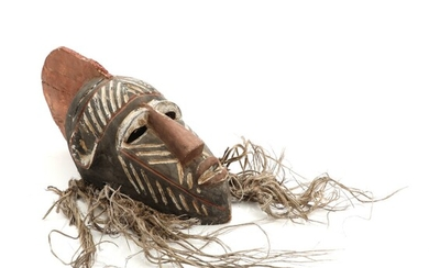 NOT SOLD. A carved and painted wood dancing mask. Songye Kifwebe style. 20th century. H....