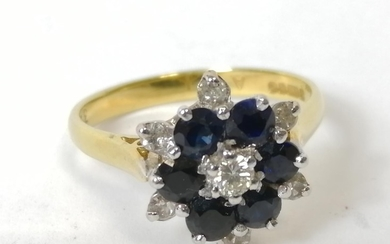 Diamond and sapphire cluster ring in 18ct gold. Size 'N'.