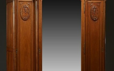 French Louis XV Style Carved Walnut Armoire, c. 1910