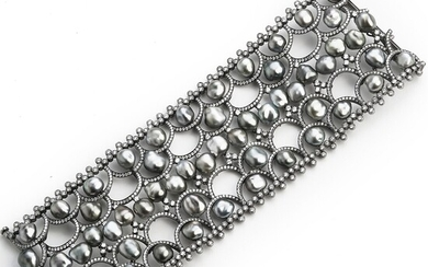 Hartmann's: A Tahiti pearl and diamond bracelet set with numerous cultured baroque Tahiti pearls and brilliant-cut diamonds, mounted in 18k white gold.