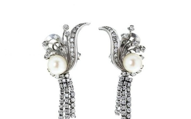 Pair of platinum and gold earrings with diamonds a