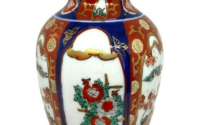 Porcelain vase. Decorated with flowers. 18 cm