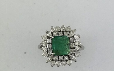 Ring in white gold 750°/°°° set with an emerald in a double entourage of round and shuttle diamonds, Finger size 54, Gross weight: 7,05g