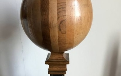Sphere composed of different slices of wood and...