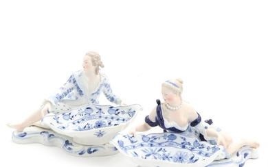 "Two Meissen porcelain figural sweetmeat dishes, decorated in underglaze blue with ""Zwiebelmuster"". H. 19. L. 31 cm. (2)"