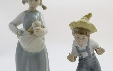 Two Nao figures with animals, A girl with kittens in