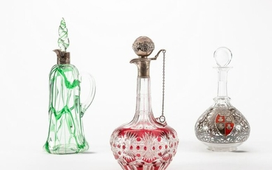Two glass claret jugs and a glass decanter