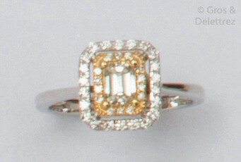 White gold ring set with a rectangular diamond...