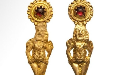 Roman Gold and Garnet Earrings with Repousse Eros