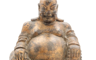 A 19th century Chinese carved wood figur of Budai, seated with his sack and marla. H. 30 cm.