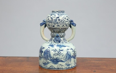 A CHINESE BLUE AND WHITE TWO-HANDLED GOURD VASE
