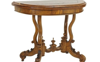 A Carved Walnut Flip-Top Games Table.
