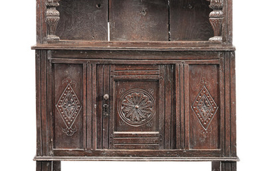 A Charles I joined and boarded oak 'mural' livery cupboard, West Country, circa 1640