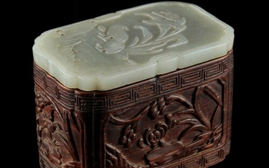 A Chinese carved hongmu rectangular ink box with very pale c...