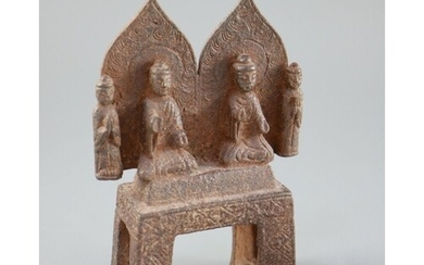 A Chinese cast iron votive group of two Buddhas and two atte...