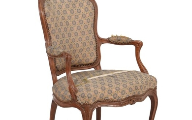 A French walnut and upholstered armchair in Louis XV style