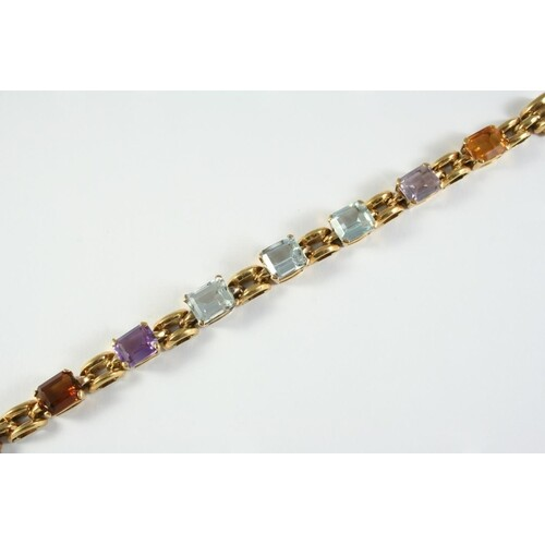 A GOLD AND GEM SET BRACELET the gold chain bracelet is mount...